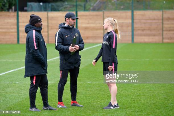 Paris SaintGermain Women head coach Olivier Echouafni and assistant coach Bernard Mendy speak with a player during a Paris SaintGermain Women's...