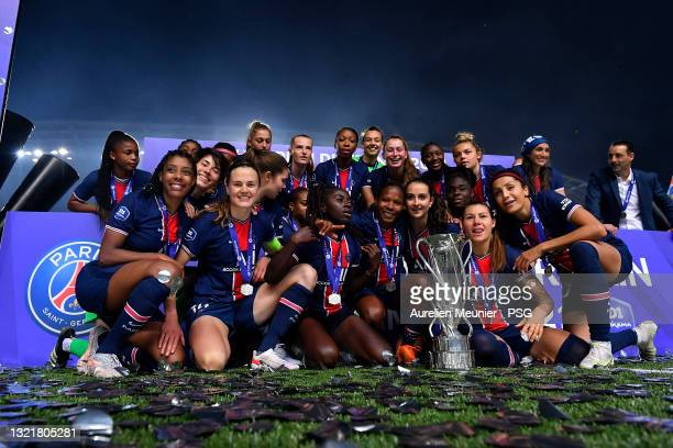 Paris Saint-Germain Women players celebrate winning the championship with the trophy after the D1 Arkema match between Paris SG and Dijon on June 04,...