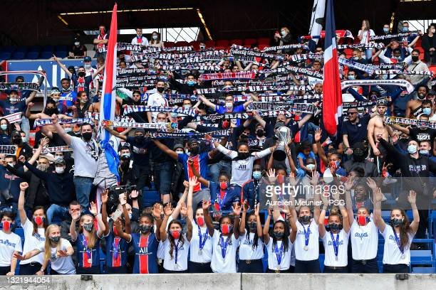 Paris Saint-Germain Women players hold the trophy in front of their fans during the Celebration of the title of French champion D1 Arkema at Parc des...