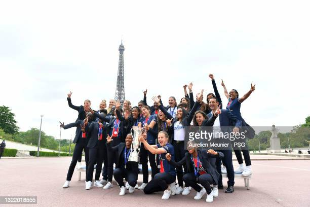 Paris Saint-Germain Women players pose with the trophy in front of the Eiffel Tower during the Celebration of the title of French champion D1 Arkema...