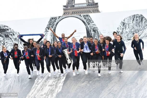 Paris Saint-Germain Women players run with the trophy in front of the Eiffel Tower during the Celebration of the title of French champion D1 Arkema...