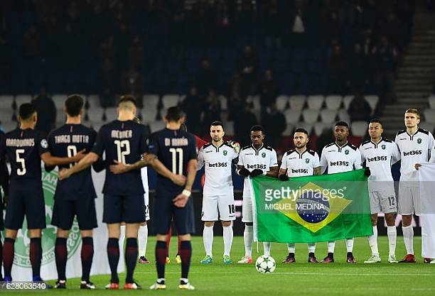 TOPSHOT Paris SaintGermain's and Ludogorets' players observe a minute's silence for the players of the Brazilian Chapecoense football team who died...