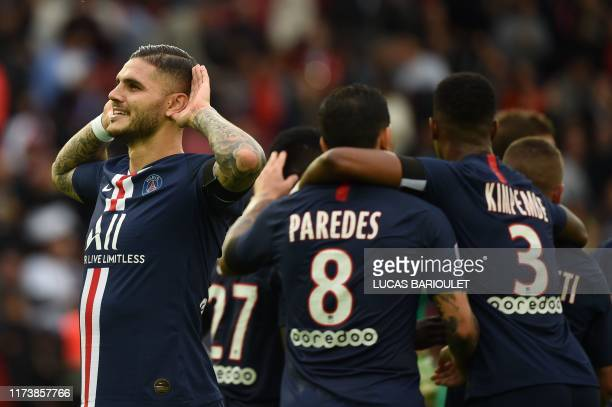 Paris SaintGermain's Argentine forward Mauro Icardi celebrates with his teammates after scoring a goal during the French L1 football match between...