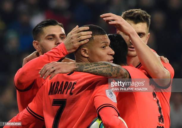 Paris Saint-Germain's Argentine forward Mauro Icardi is congratulated by teammates after scoring a goal during the French L1 football match between...