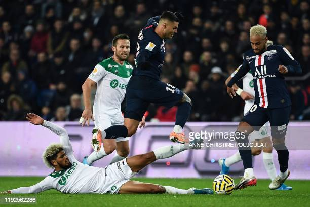Paris Saint-Germain's Argentine forward Mauro Icardi jumps with the ball over Saint-Etienne's French midfielder Mahdi Camara during the French League...