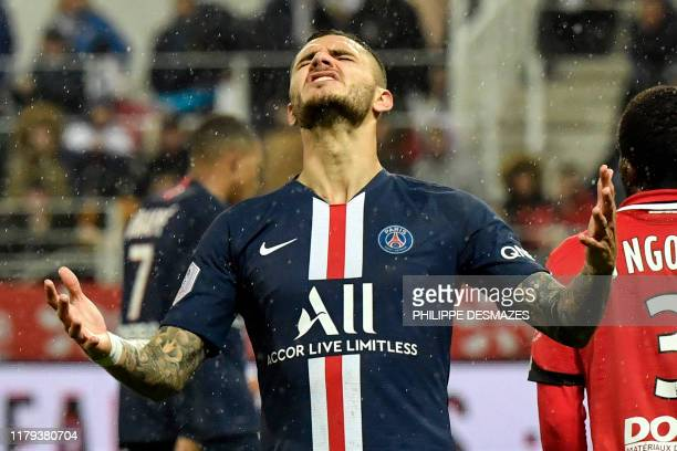Paris SaintGermain's Argentine forward Mauro Icardi reacts after missing an opportunity to score during the French L1 football match between Dijon...