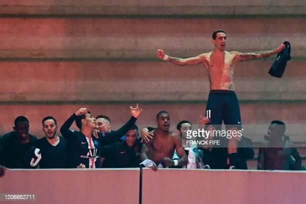 Paris SaintGermain's Argentine midfielder Angel Di Maria anc teammates celebrate with supporters outside the Parc des Princes stadium in Paris on...