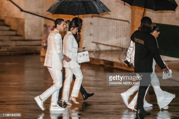 Paris SaintGermain's Argentine midfielder Angel Di Maria and his wife Jorgelina Cardoso arrive to attend the birthday party of Paris SaintGermain's...