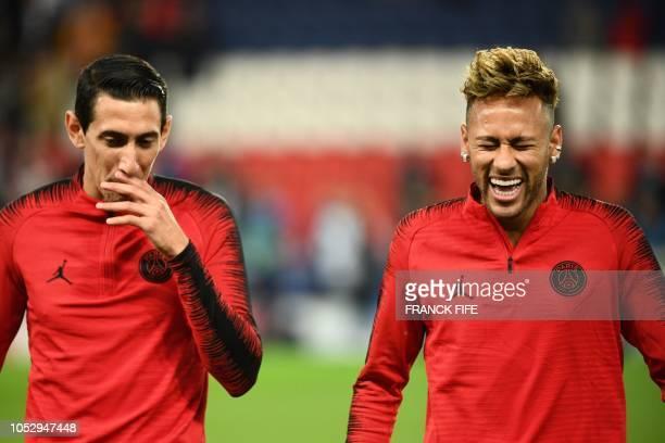 TOPSHOT Paris SaintGermain's Argentine midfielder Angel Di Maria and Paris SaintGermain's Brazilian forward Neymar joke together prior to the UEFA...