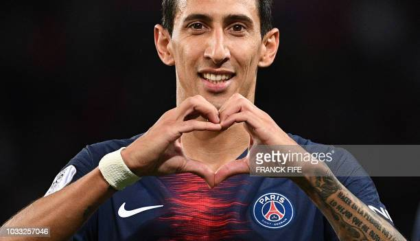 Paris Saint-Germain's Argentine midfielder Angel Di Maria celebrates after scoring a goal during the French L1 football match between Paris...