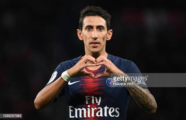 Paris SaintGermain's Argentine midfielder Angel Di Maria celebrates after scoring a goal during the French L1 football match between Paris...