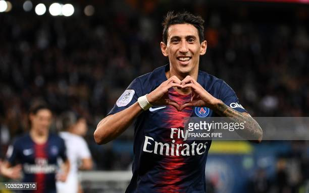 TOPSHOT Paris SaintGermain's Argentine midfielder Angel Di Maria celebrates after scoring a goal during the French L1 football match between Paris...