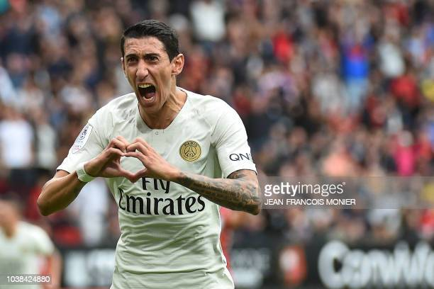 Paris SaintGermain's Argentine midfielder Angel Di Maria celebrates after scoring the equalizer during the French L1 football match between Rennes...