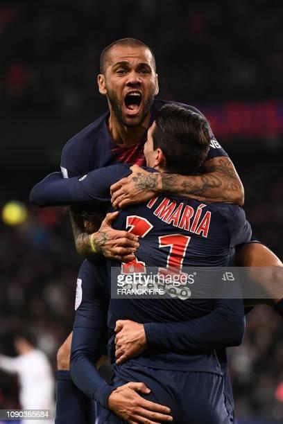 Paris Saint-Germain's Argentine midfielder Angel Di Maria celebrates with Paris Saint-Germain's Uruguayan forward Edinson Cavani and Paris...