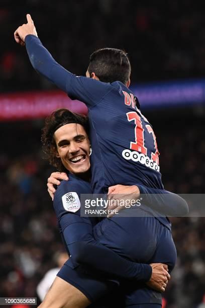 Paris Saint-Germain's Argentine midfielder Angel Di Maria celebrates with Paris Saint-Germain's Uruguayan forward Edinson Cavani after scoring a goal...