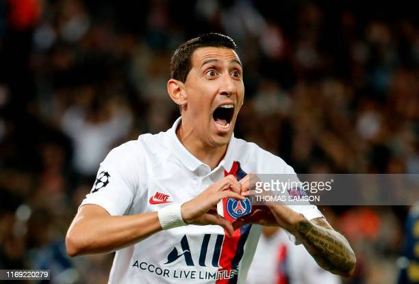TOPSHOT Paris SaintGermain's Argentine midfielder Angel Di Maria celebrates scoring his team's first goal during the UEFA Champions league Group A...
