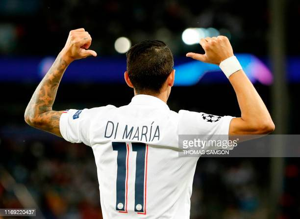 Paris Saint-Germain's Argentine midfielder Angel Di Maria celebrates scoring his team's first goal during the UEFA Champions league Group A football...