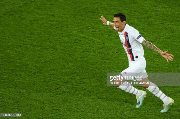 Paris Saint-Germain's Argentine midfielder Angel Di Maria celebrates after scoring a goal during the UEFA Champions league Group A football match...