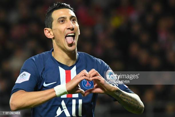 Paris Saint-Germain's Argentine midfielder Angel Di Maria celebrates after scoring the opening goal during the French L1 football match between Stade...