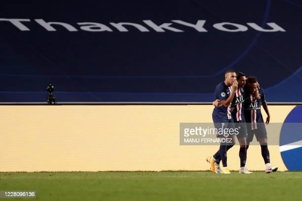 Paris Saint-Germain's Argentine midfielder Angel Di Maria celebrates with Paris Saint-Germain's Brazilian forward Neymar and Paris Saint-Germain's...
