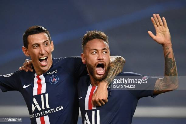 Paris Saint-Germain's Argentine midfielder Angel Di Maria celebrates with Paris Saint-Germain's Brazilian forward Neymar after scoring his team's...