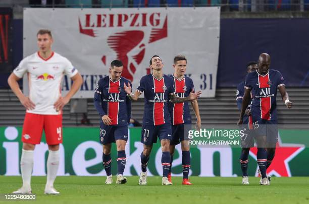 Paris Saint-Germain's Argentine midfielder Angel Di Maria celebrates scoring the opening goal with his teammates during the UEFA Champions League...