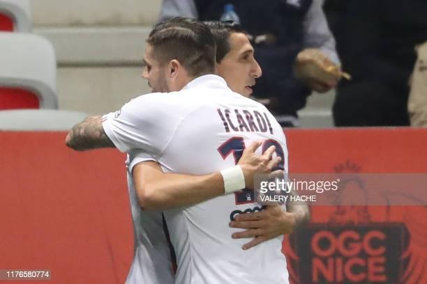 Paris Saint-Germain's Argentine midfielder Angel Di Maria is congratulated by Paris Saint-Germain's Argentine forward Mauro Icardi after scoring a...