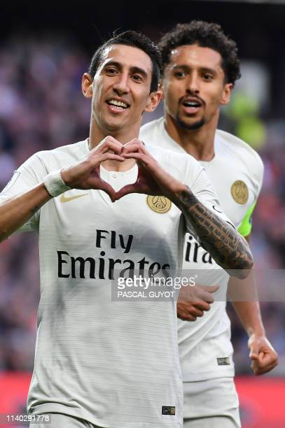 Paris SaintGermain's Argentine midfielder Angel Di Maria makes a heart shape with his hands as he celebrates after scoring a goal during the French...