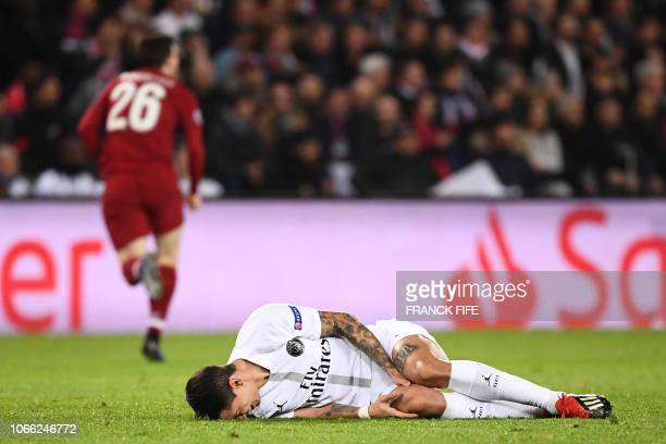 Paris Saint-Germain's Argentine midfielder Angel Di Maria reacts after falling on the football pitch during the UEFA Champions League Group C...