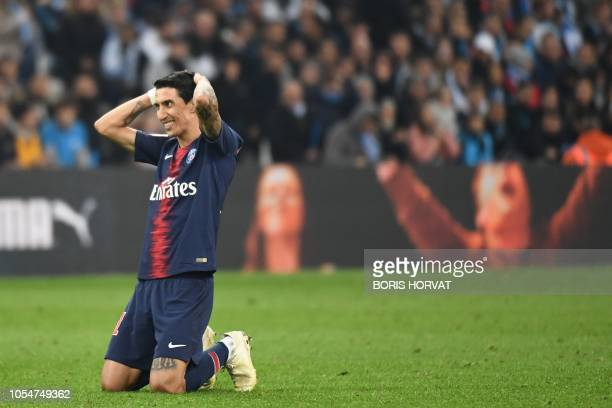 Paris SaintGermain's Argentine midfielder Angel Di Maria reacts during the French L1 football match between Olympique de Marseille and Paris...