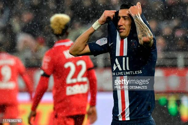 Paris Saint-Germain's Argentine midfielder Angel Di Maria reacts during the French L1 football match between Dijon Football Cote-d'Or and Paris...