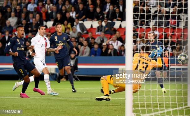 TOPSHOT Paris SaintGermain's Argentine midfielder Angel Di Maria scores his team's first goal during the UEFA Champions league Group A football match...