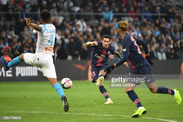Paris SaintGermain's Argentine midfielder Angel Di Maria shoots the ball during the French L1 football match between Olympique de Marseille and Paris...