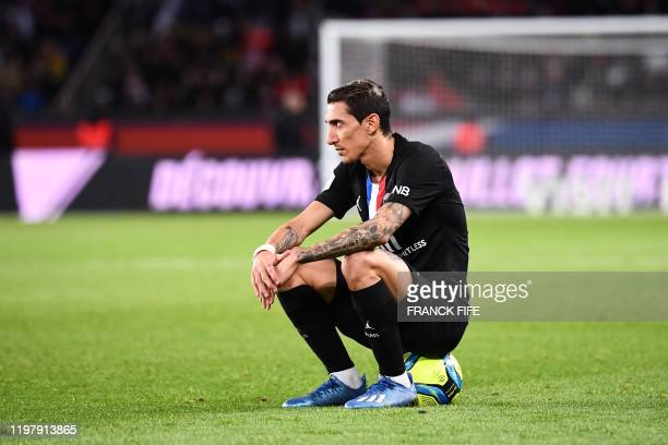 Paris Saint-Germain's Argentine midfielder Angel Di Maria sits on the ball during the French L1 football match between Paris Saint-Germain and...