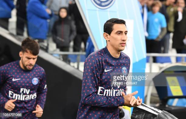 Paris SaintGermain's Argentine midfielder Angel Di Maria warms up prior to the French L1 football match between Olympique de Marseille and Paris...