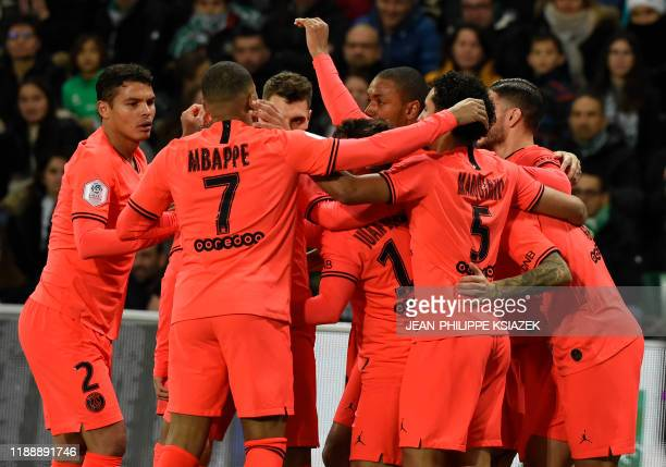 Paris Saint-Germain's Argentine midfielder Leandro Paredes is congratulated by teammates after scoring a goal during the French L1 football match...