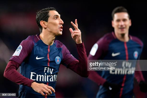 Paris SaintGermain's Argentinian forward Angel Di Maria and Paris SaintGermain's German midfielder Julian Draxler celebrate after Di Maria opened the...