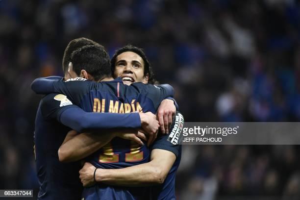 TOPSHOT Paris SaintGermain's Argentinian forward Angel Di Maria celebrate with Paris SaintGermain's German forward Julian Draxler and Paris...