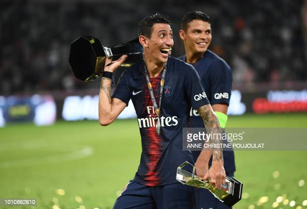 Paris SaintGermain's Argentinian forward Angel Di Maria celebrates with the trophy after winning the French Trophy of Champions football match...