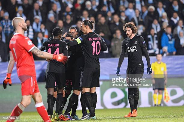 Paris SaintGermain's Argentinian forward Angel Di Maria celebrates scoring with his teammates during the UEFA Champions League Group A secondleg...