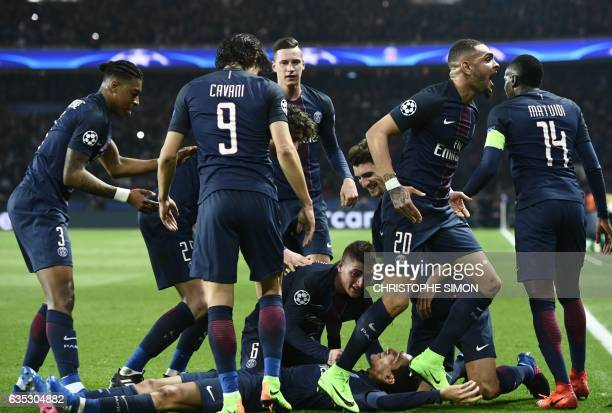 Paris Saint-Germain's Argentinian forward Angel Di Maria celebrates with teammates after scoring a goal during the UEFA Champions League round of 16...