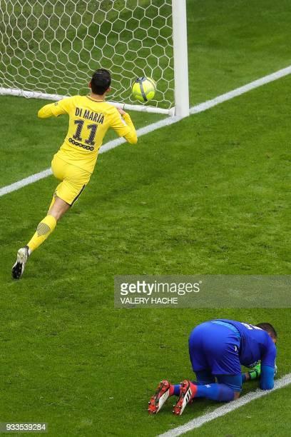 Paris SaintGermain's Argentinian forward Angel Di Maria celebrates after scoring an equalizer past Nice's Argentinian goalkeeper Walter Benitez...