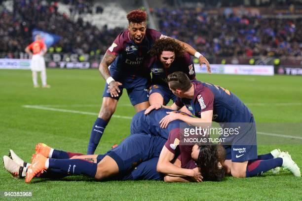 Paris SaintGermain's Argentinian forward Angel Di Maria celebrates scoring his team's second goal with teammates French forward Kylian Mbappé...