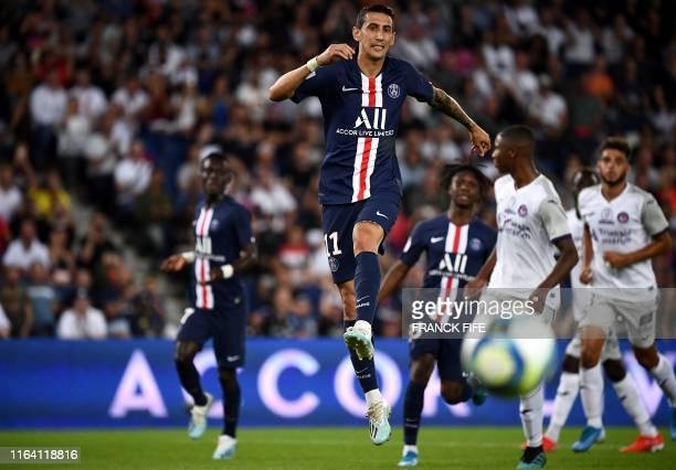 Paris SaintGermain's Argentinian forward Angel Di Maria eyes the ball during the French Ligue 1 football match between Paris SaintGermain and...