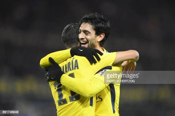 Paris SaintGermain's Argentinian forward Angel Di Maria is congratulated by Paris SaintGermain's Argentinian forward Javier Pastore after scoring a...