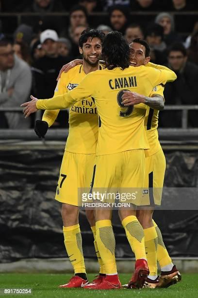 Paris SaintGermain's Argentinian forward Angel Di Maria is congratulated by Paris SaintGermain's Argentinian forward Javier Pastore and Paris...