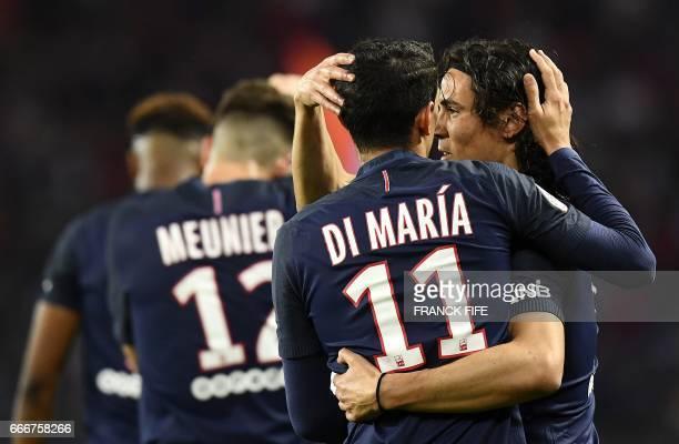 Paris SaintGermain's Argentinian forward Angel Di Maria is congratuled by teammate Paris SaintGermain's Uruguayan forward Edinson Cavani after...