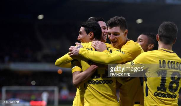 Paris SaintGermain's Argentinian forward Angel Di Maria is congratuled by teammates after scoring a goal during the French L1 football match between...