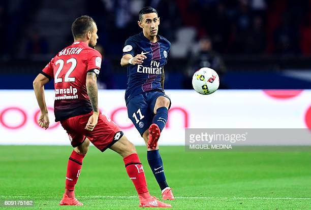 Paris SaintGermain's Argentinian forward Angel Di Maria kicks the ball next to Dijon's French midfielder Johan Gastien during the French L1 football...