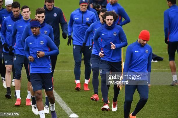 Paris SaintGermain's Argentinian forward Angel Di Maria Paris SaintGermain's Italian midfielder Thiago Motta Paris SaintGermain's German midfielder...